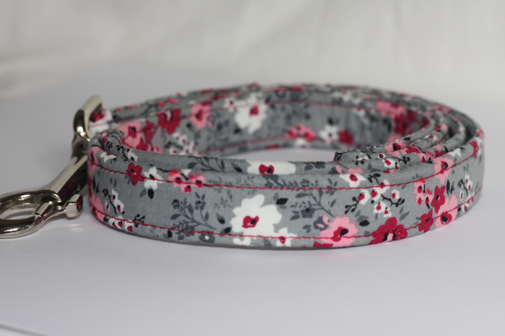 pink pansy on grey dog lead